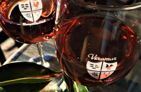 Two glasses with red wine and Veramar label