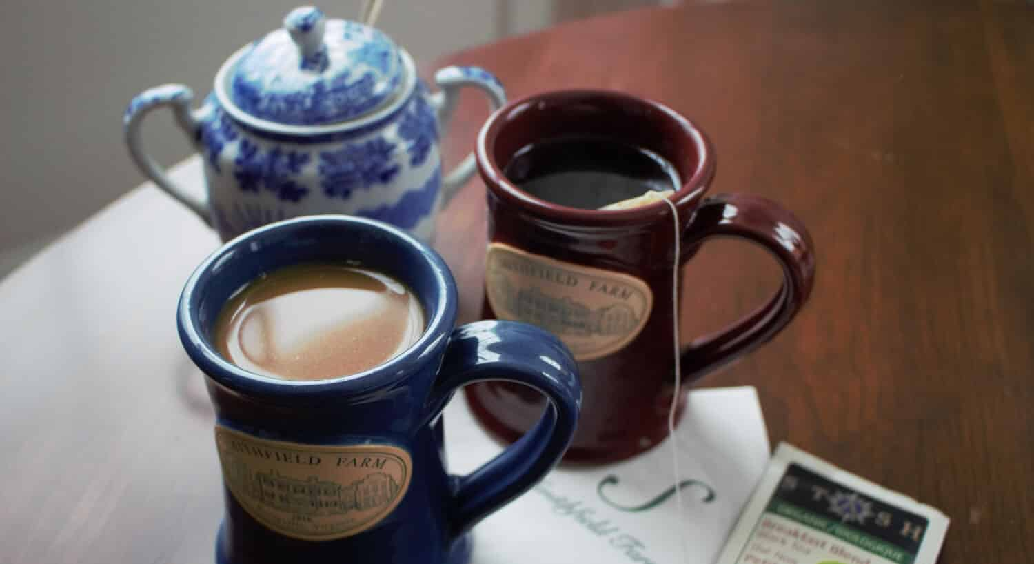 Two coffee mugs with the Smithfield Farm Bed and Breakfast logo on them