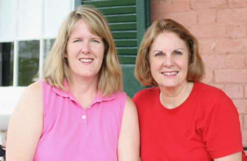 Smithfield Farm hostesses in pink and red tops smile at the camera