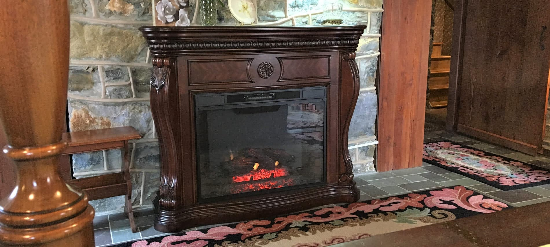 Antique carved fireplace with a gas fire inset